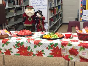 Santa and the Snowman eagerly await lunch with the library club.